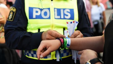 Continued issue with a police officer attaching a bracelet with the text #tafsainte, meaning don't grope, to a visitor's wrist at the Bravalla Festival in Norrkoping, Sweden, in 2016 after reports of five rapes and more than a dozen suspected sexual assaults.