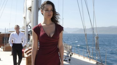 Women in the Bond films are no longer mere background characters: James Bond (Daniel Craig) and Severine (Berenice Marlohe) in <i>Skyfall</i>.
