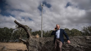 Telstra chief executive Andrew Penn next to the 100th base station built under the government's Mobile Black Spots Program.