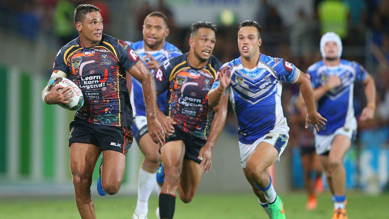 Veteran on the run: Justin Hodges makes a break for the Indigenous All Stars.