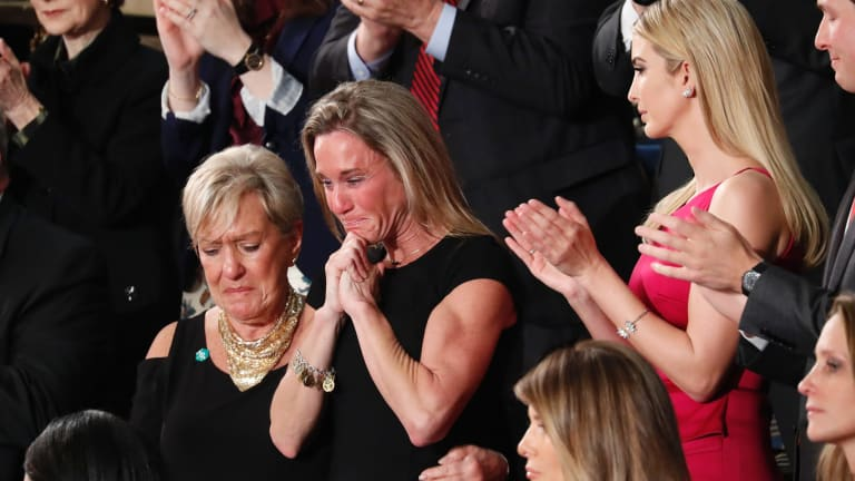 An emotional Carryn Owens, widow of Navy SEAL Ryan Owens, after she was acknowledged by President Donald Trump during his address to a joint session of Congress.