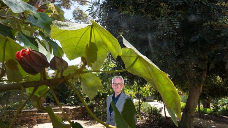 Australian Garden History Society member Trevor Pitkin in the system garden at Melbourne University.