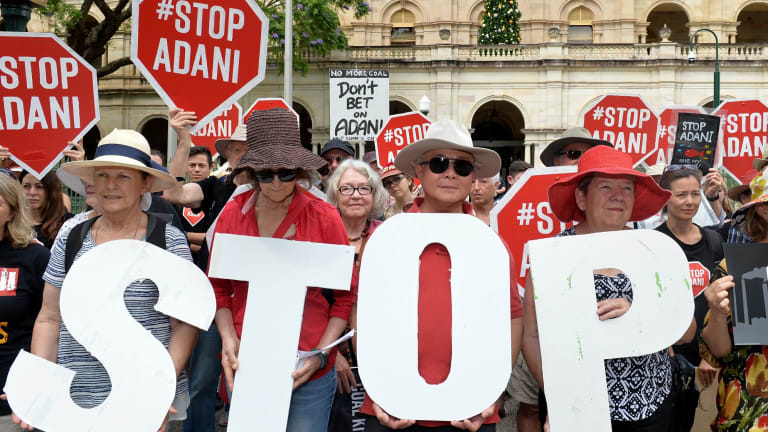 Anti-Adani protesters protest outside Queensland's Parliament House in Brisbane.