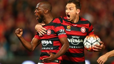 Wanderers Romeo Castelen and Brendon Santalab celebrate during their semi-final win over the Roar.