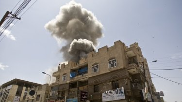 Smoke rises from a house of former Yemeni president Ali Abdullah Saleh after a Saudi-led air strike in the capital Sanaa in May.