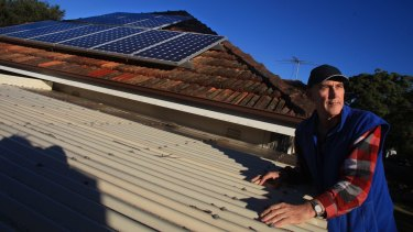 Peter Thompson with solar panels on the roof of his home in Miranda. There is no planned change to the popular roof-top solar scheme.