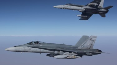 F/A-18A Hornets from Australia's Air Task Group fly in formation with a Royal Australian Air Force KC-30A Multi Role Tanker Transport aircraft.