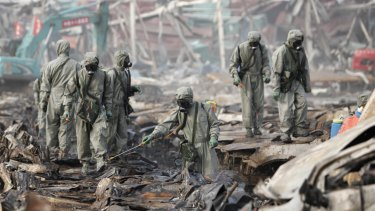 Rescuers spray hydrogen peroxide at the site of a chemical warehouse explosion in Tianjin, China, in August. From that 170 people were killed.