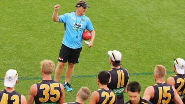 All bets are off: Tigers head coach Damien Hardwick speaks to his players during a training session. Richmond will no longer have any sponsorship deals with sports betting agencies.