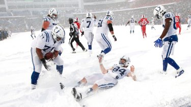 Indianapolis Colts tight end Jack Doyle (centre) celebrates in the end zone.