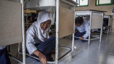 Lhok Nga school students practice a tsunami drill.