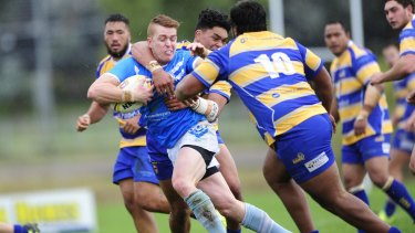 Kahi Harawira of the Woden Valley Rams tackles Craig Wilkinson of the Queanbeyan Blues.