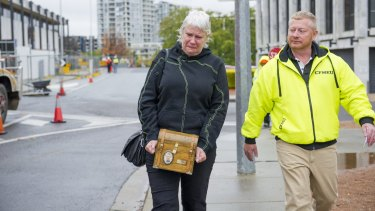 Kay Catanzariti leaves the Magistrates Court holding her sons ashes and wearing his jumper.