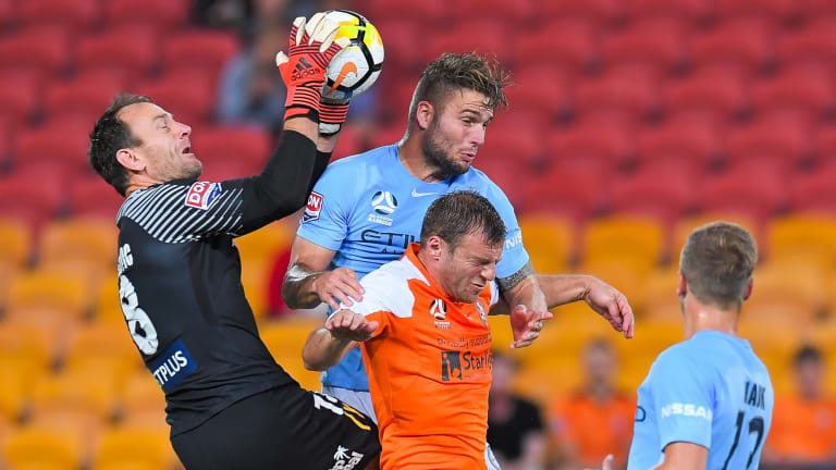 City goalkeeper Eugene Galekovic in action as Bart Schenkeveld and Roar's Avram Papadopoulos compete.