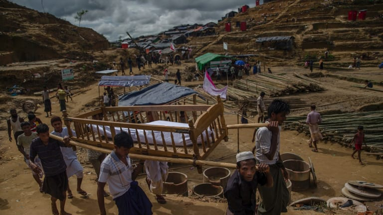The body of an elderly Rohingya man is carried on a stretcher during his funeral near Taiy Khali refugee camp, Bangladesh, on Wednesday.