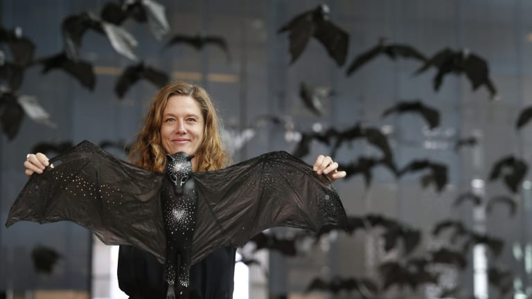 Artist Kathy Holowko and her installation artwork Batmania at Federation Square.