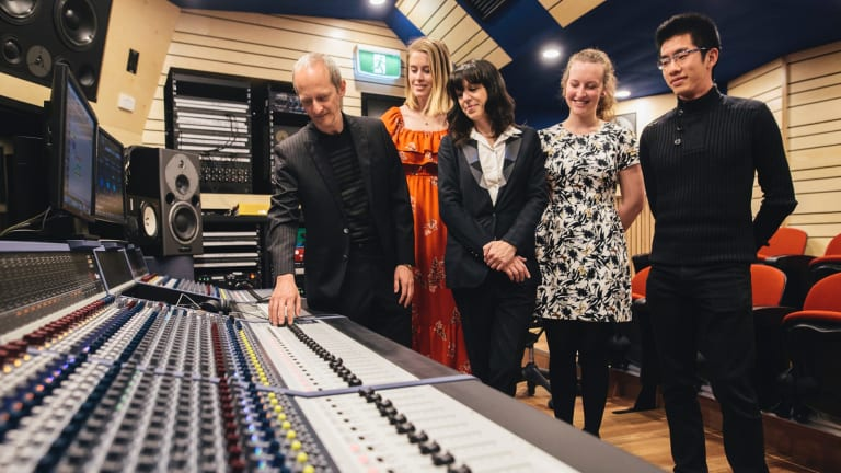 ANU School of music's Ken Lampl and Samantha Bennett with students Amy Jenkins (second from left) Jacqui Douglas (second from right) and Aaron Chew (right) at the opening of the new recording studio at the school.