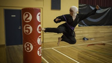 17-year-old Saleha Amin from South Granville High taking part in a tae kwon do practice run by Master Ridvan in Auburn.