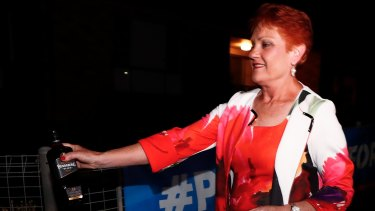 Pauline Hanson departs with a bottle of Bundaberg Rum.