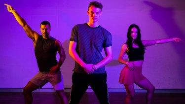 Saturday Night Fever choreographer, Mitchell Woodcock, with stars Euan Doidge and Melanie Hawkins.