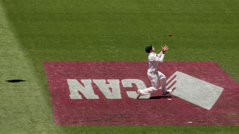 Oops: Steve Smith tries to catch KL Rahul as the shadow of Spidercam hovers in the background.
