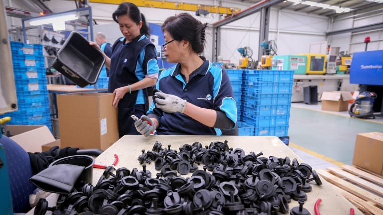 Workers at Dolphin Products which has transitioned away from a dependence on auto manufacturing.