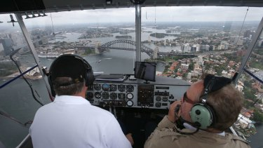 Pilot Mark Finney (left) and Fairfax's Tim Barlass aboard the Appliances Online airship.