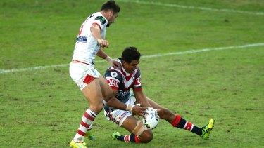Oops: Gareth Widdop kicks the ball ahead to score a try after a fumble by Latrell Mitchell.