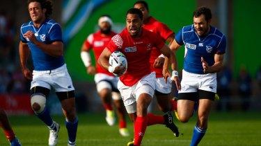 Tonga's Telusa Veainu makes a break against Namibia at Sandy Park in Exeter, United Kingdom.