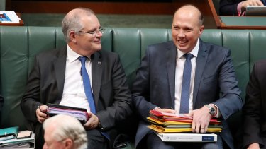 Immigration and Border Protection Minister Peter Dutton and his predecessor Scott Morrison