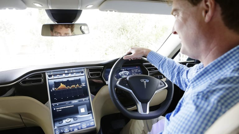 Entrepreneur Andrew Dent controls some of his high-tech Tesla's functions with his mobile phone.