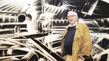 Ken Adam stands in front of one of his futuristic designs at the exhibition James Bond – Berlin – Hollywood in Berlin in 2002.
