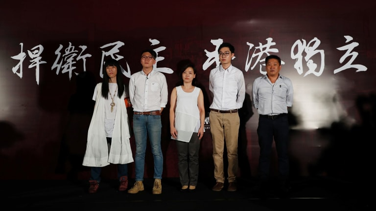Five candidates who have been rejected to participate in the Legislative Council elections, from left: Nakade Hitsujiko, Edward Leung, Alice Lai, Andy Chan Ho-tin and James Chan Kwok-keung, attend a rally outside the Hong Kong government headquarters on August 5.