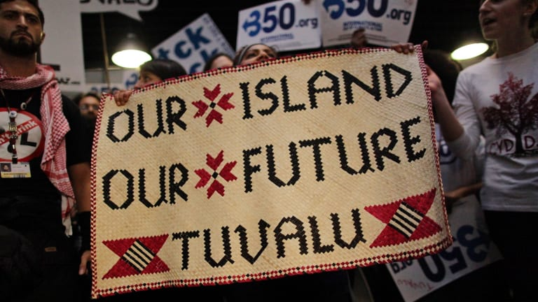 Activists supporting the tiny Pacific island of Tuvalu demand a better deal for island states at the UN climate summit in Copenhagen, 2009.