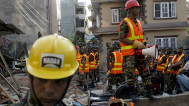 The Nepalese Army working on a collapsed house in Kathmandu on Tuesday.