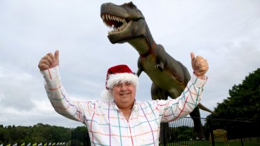 In happier times ... Clive Palmer with Jeff the dinosaur which was destroyed by fire..