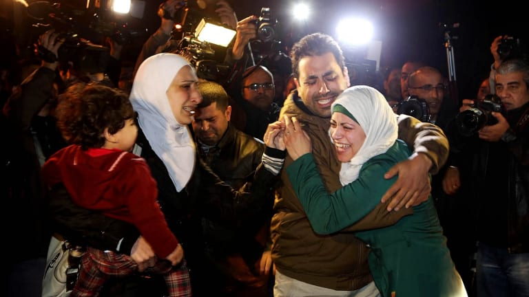 Heartbroken: A man comforts the wife of Jordanian pilot Muath al-Kasasbeh on Wednesday before the video surfaced.