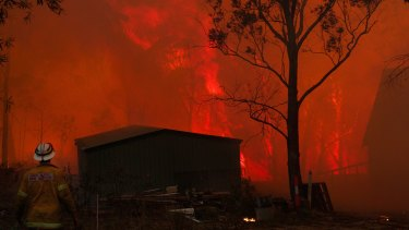 Bushfires close in on a home near Dargan in the Blue Mountains in 2013.