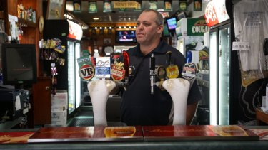 Sombre mood: Nambucca Hotel publican Chris McDonald says Macksville is in shock over the untimely death of favourite son Phillip Hughes.