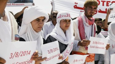 Yazidi Kurds at a protest in Dohuk, Iraq, against the Islamic State's invasion on Sinjar city a year ago.