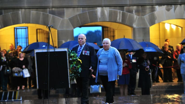 Representing the Bell family are from left, Alan Hall and his wife Laureen both of Melbourne lay a wreath during the Last Post ceremony at the Australian War Memorial in Canberra for Flight Lieutenant John Napier Bell.