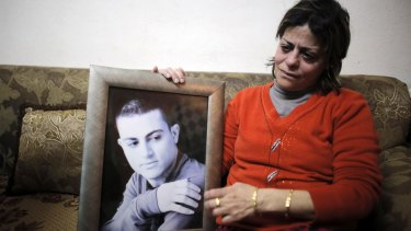 The mother of Muhammad Musallam with her son's photo in February.