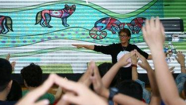 Australian children's book writer Bronwyn Bancroft interacts with students at the Beijing Fangcaodi International School during Australian Writers' Week.