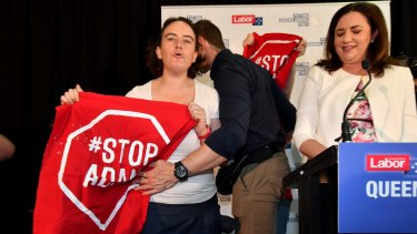 Premier Annastacia Palaszczuk's campaign speech was interrupted by anti-Adani protesters.