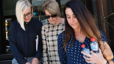 Ray Walker's widow Jennifer Walker, centre, with daughter Kate Herztog, right, leave court on Wednesday.