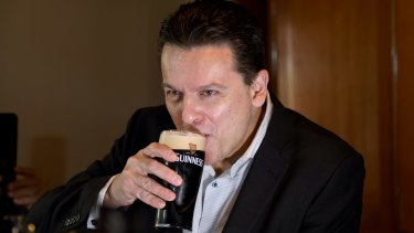 Nick Xenophon toasts the news that he's a British citizen earlier this year.