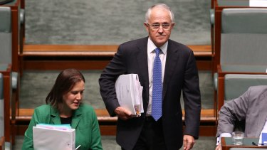Prime Minister Malcolm Turnbull and Assistant Treasurer Kelly O'Dwyer arrive for question time on Wednesday.