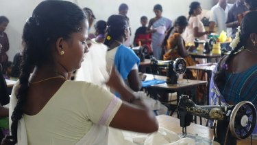 Fabric mill workers in Tamil Nadu in India. Many are underpaid and overworked.