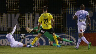 Kaine Sheppard of Heidelberg United (22) has his shot at goal stopped by City goalkeeper Tando Velaphi.