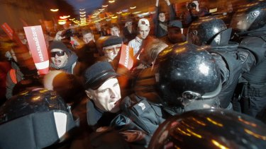Protesters try to break through a riot police cordon during a rally in St. Petersburg on  Saturday.
